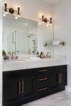 Brass hardware adds a warm and delicate contrast to the black cabinets. Bathroom Renos, Small Bathroom, Black Bathrooms, Condo Bathroom, Concrete Bathroom, Master Bathrooms, Bathroom Design Luxury, Luxury Bathrooms, Dream Bathrooms