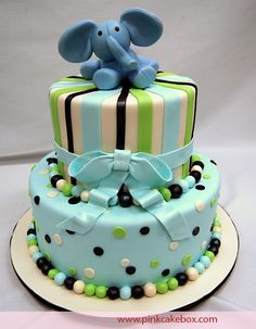 Cute birthday cake for little boy, blues and greens with elephant on top