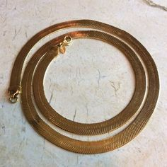 Vintage Monet Necklace gold fill  TO BUY: Comment with your email address, and you'll receive a secure checkout link.  Price: $59.99.  Nice Monet necklace. 22 inches long & 1/4 inch wide flat chain. Very flashy bright gold. It has a decent sized lobster c