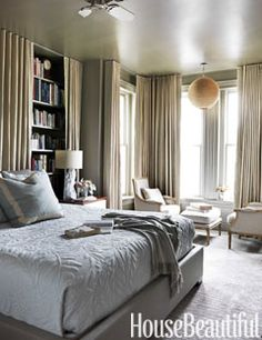 Barry Dixon painted the walls and the ceiling in the master bedroom in a Ralph Lauren metallic paint that has the luster of pewter. It bathed the room in this luminous color.