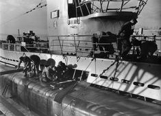 A work crew in Wilhemshaven, Germany goes at it to repair sub U-30 after a combat patrol. At any given time, at least 1/3 of the submarine fleet was in harbor undergoing repairs, thus removing precious assets from combat. The German submarine campaign essentially failed because of the shortage of boats and the quick development of anti-sub technologies by the allies.