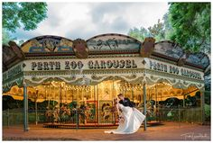 Bride & Groom Wedding Portrait at the iconic Perth Zoo Carousel.  Photography by Trish Woodford Photography