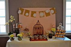 Would love to use a birdcage on our table -- I have three white ones (one big, two little)!!! #babyshower