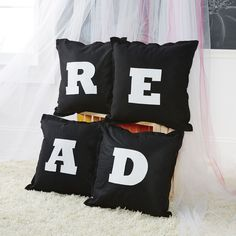 Make your reading corner a little cozier with these stylish felt pillows.