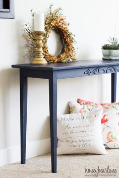 I love this navy blue console table!  She just painted it with chalk paint!