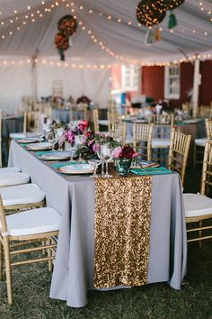 gold wedding accents - photo by Emily Delamater Photography http://ruffledblog.com/maine-wedding-with-an-emerald-green-gown
