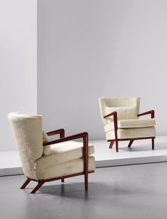 Jean Royère; Okoumé and Hide 'Écusson' Armchairs, 1957.  I want these! Any resource that you know of? Thanks