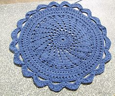 Unique Circular Crochet Rug with a spiral centrepiece, cross stitch and scalloped edges.