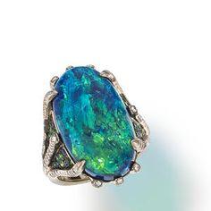 An opal, diamond and gem-set ring