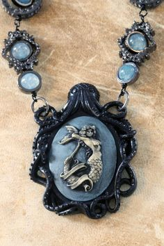 Black Octopus with Blue Mermaid Cameo and Dragon Veins Agate