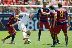 Wayne Rooney #10 of Manchester United gets caught in coverage against Adriano #21 of FC Barcelona in the first half during the International Champions Cup on July 25, 2015 at Levi's Stadium in Santa Clara, California. Manchester United won 3-1.