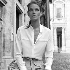 A slightly more contemporary version of our Gathered Silk Shirt, this top leverages a softly rounded collarless band, seamless sleeve construction, and delicate covered plackets to create a subtle yet standalone effect. Made from the same thick, heavyweight silk crepe de chine (a 22mm weight vs. 14-16mm for comparably priced silk shirts), and just as essential and easy for day-to-day wear.