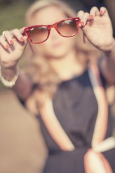 cool photograph blurred backround with sunset red lense sunglasses