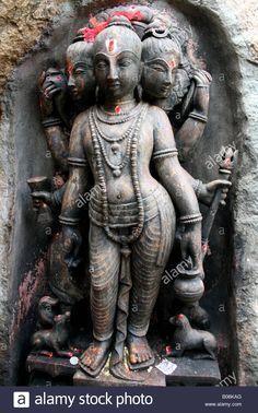 Trimurti temple statue with Brahma , Shiva and Vishnu making the supreme being, India Stock Photo