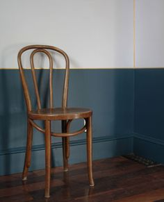 Petrol blue & dove gray walls with gold accent line. Classic wood chair.