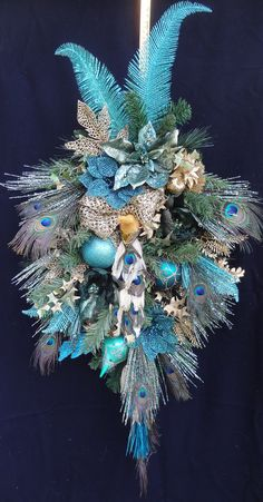 Wow...Beautiful Teal and Gold Swag with Peacock Feathers...Decorated with Peacock, Ornate Ornaments, Beaded Poinsettias and Glitter Feathers