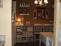Pinterest Craft Room Armoire | cafe curtain rods for ribbon storage