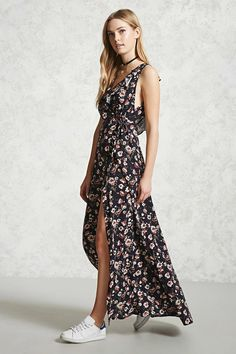 A woven maxi dress featuring an allover floral print, a wrap design with a self-tie at the side, a surplice V-neckline, sleeveless cut with ruffle straps, a cutout back, and a concealed back zipper.