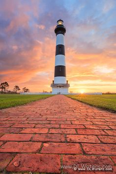 A brick path leading to Bodie Island Lighthouse at sunrise on the Outer Banks of North Carolina. | Pictures of the Outer Banks