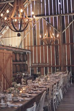 barn wedding // mix and match chairs + chandeliers + long table