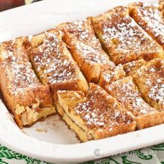 Texas French Toast Bake Recipe Desserts, Breakfast and Brunch with melted butter, light brown sugar, Texas toast bread, large eggs, whole milk, vanilla extract, light brown sugar, powdered sugar, maple syrup