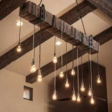 DIY light fixture with reclaimed beam and Edison bulbs