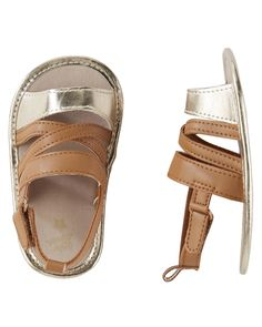 Your hunt for the perfect crib shoes is over! These baby sandals with metallic details help her crawl from point A to point B in style.