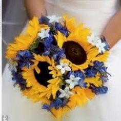 or this but with some blue flowers....and brown ribbon wrapped around the stems