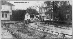 Alton Telegraph photo of work being done on the Square to round off the corners and widen the roadway. State House Square, Alton, Illinois