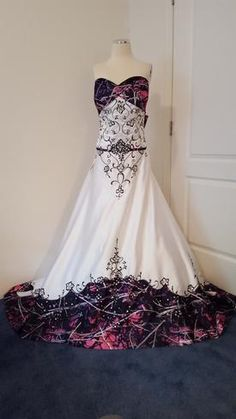 Shown in Muddy Girl camo with white satin for the main gown