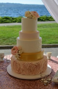 Blush pink and gold wedding cake with handpiped details, sugar flowers and fondant ruffle rosettes. Image by Carla Reich.