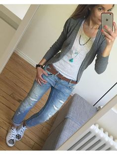 Military green cardigan, white t-shirt, skinny jeans, white tennis shoes, camel belt, long pendant necklaces