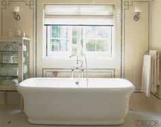 I've always loved the wall tile in this bathroom.Very 1920s.  From Elle Decor via breakfastattoast.com