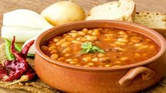 Enjoy this hearty stew with chicken sausage or a vegetarian alternative. Sausage Stew, Beans And Sausage, Chicken Sausage, Veg Recipes, Greek Recipes, Healthy Recipes, Chicken And Veg Soup, Halloumi Burger, Romanian Food