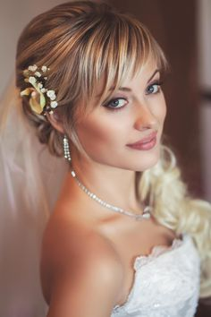 1. There are several rules for incorporating real flowers into a wedding hairstyle. For starters, flowers work best incorporated into an updo that has some structure, rather than a style where your hair is left down and loose. I recommend that you tell your hairstylist up front that you would like to incorporate real flowers into your wedding style, and he or she can help you determine both the most appropriate style and the most flattering flower for it.