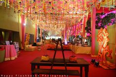 Wedding venue decorated with floral strings with quirky ends, kaliras and floral pasted stand alones