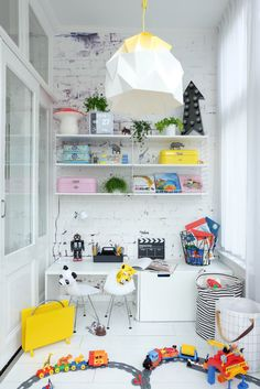 Storage in Bea Kroze's house is quite a colorful affair. We love the gig variety of shapes, shades and structures.