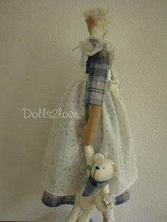 Tilda doll Caitlin wearing a soft blue checkered by Dolls2love