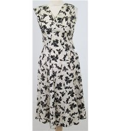 """""""Lovely dress from Sambo Fashions in cream slubbed fabric with a black floral design in flocked velvet.(Sambo was the brand name for Samuel Sherman who later designed for the Dollyrockers label). """""""
