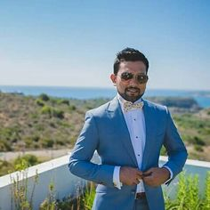 Wedding in Crete..   Groom's styling in Blue and White suite.