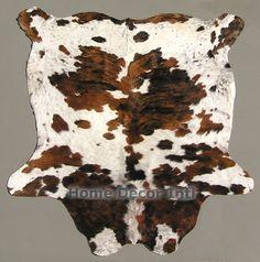 exotic brown tricolor Colombian cowhide rug cowhidesinternational.com