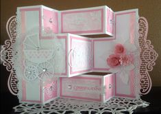 Here is abeautiful baby shower card I made yesterday usinga variety of dies from Heartelt Creations, Marianne Creatables, Tattered Lace, Cheery Lynn, Spellbinders rolled mini rosess, Memory Box b...