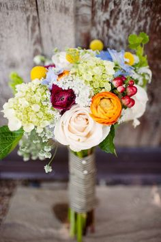 i like the natural simplicity of this bouquet...variety of colors/flowers