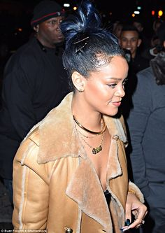 Winter warmer: But Rihanna didn't look at all bothered by the wintry weather as she went to the 40/40 club with her beau to a viewing party of the Cotto vs Canelo boxing fight