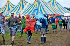 Brightly-coloured kagools keep revellers at Leeds Festival dry as the three-day event was . Enjoy The Sunshine, Rain Shower, Leeds, Cool Pictures, Two By Two, Good Things, Reading, Day, Music Festivals