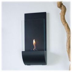 Torcia provides a sophisticated and streamlined aesthetic to any space using a cambered, black powder-coated frame and tempered glass windscreen. This fireplace offers an eco-friendly flame that is odorless. Bio Ethanol, an alternative fuel source produced from plants, only emits water vapor and carbon dioxide into the air, therefore no chimney or flue is needed.