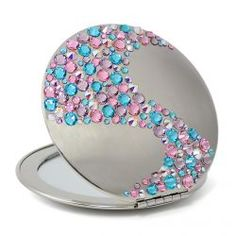 Compact mirror with lots of color on it