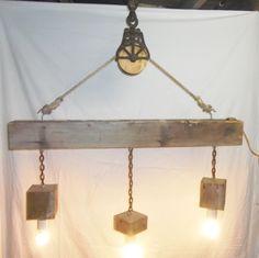 Reclaimed Barn Beam and Pulley 3 Light Chandelier by TKreclaimedART on Etsy https://www.etsy.com/listing/174111525/reclaimed-barn-beam-and-pulley-3-light