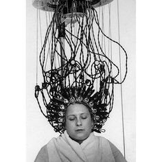 """From the December 21 1936 photo essay on 'Permanent Waves'  """"The hair above has been wet with alkaline solution wound tight around rods then covered with electrically-heated clamps. The solution opens the hairs sealy surface permitting steam produced by hot clamps on damp hair to penetrate the cells."""" (Alfred EisenstaedtThe LIFE Picture Collection/Getty Images) #tbt #throwbackthursday by life"""