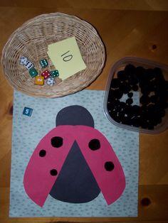 dots on a ladybug using black pom poms